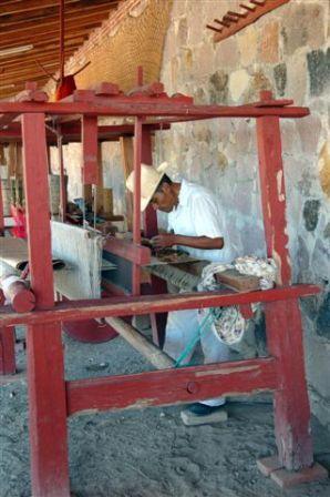 at his loom